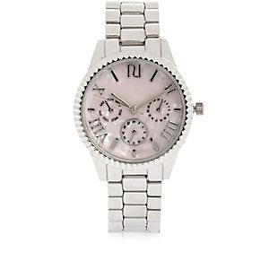 Silberne Armbanduhr mit Münzrand