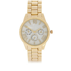 Gold tone coin edge watch