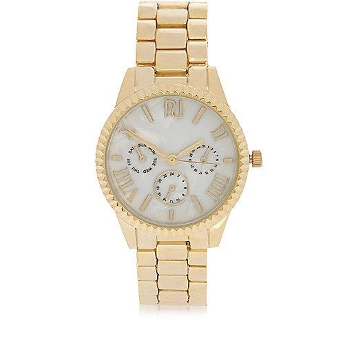 Gold tone coin edge watch