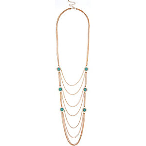 Gold tone turquoise long necklace
