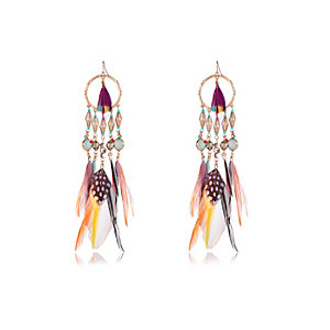 Gold tone feather dangle earrings