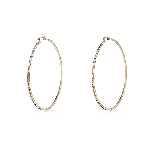 Gold tone glitter hoop earrings