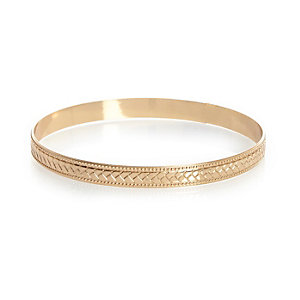 Gold tone engraved arm cuff