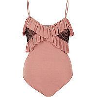 Light pink frilly bodysuit