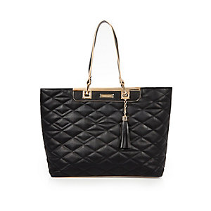 Black quilted tote handbag