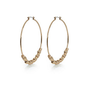Gold tone beaded hoop earrings