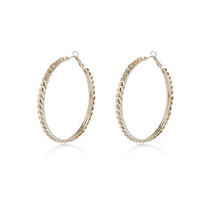 Gold tone decorative hoop earrings