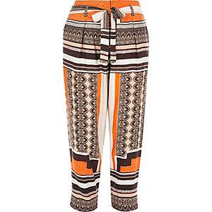 Orange print tapered trousers