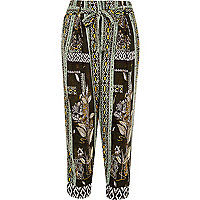 Green print tapered trousers