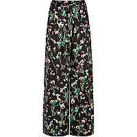 Black floral print trousers