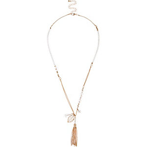 Gold tone tassel necklace