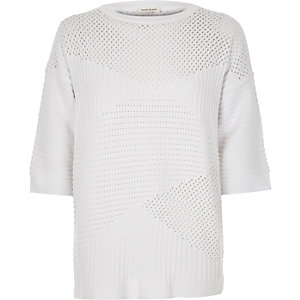 White pointelle soft knit sweater
