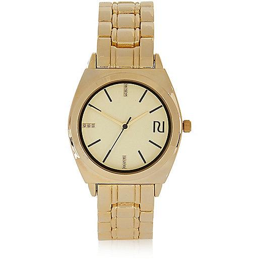 Gold tone chain watch