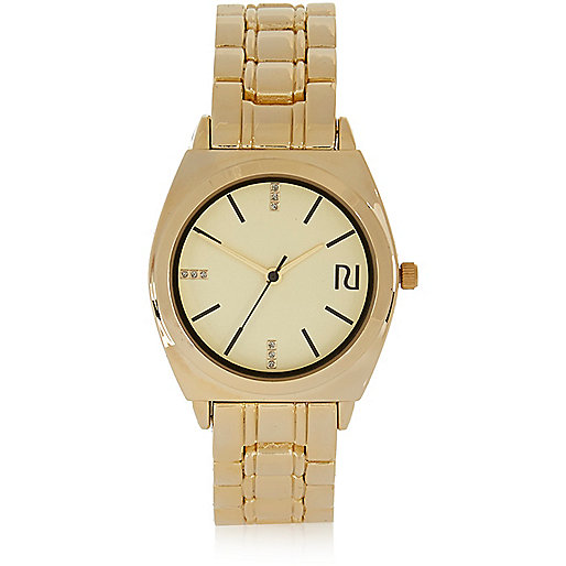 Gold tone chain watch
