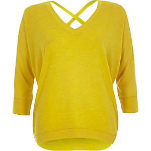 Yellow knitted V-neck cross back sweater
