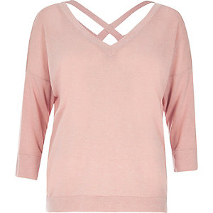 Pastel pink knitted V-neck cross back sweater