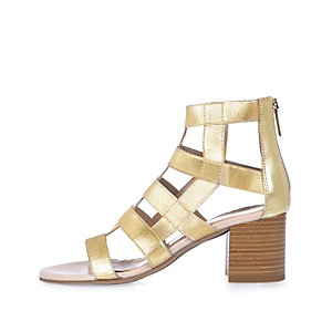 Gold caged heel shoe boots