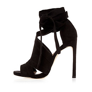 Black cut-out heel shoe boots