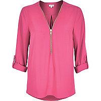 Pink zip-up blouse