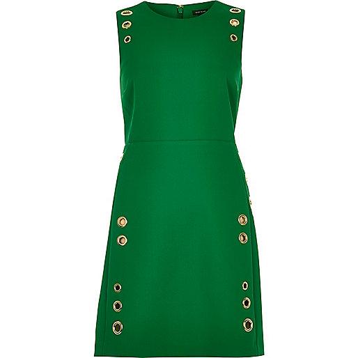 Robe trapèze verte à œillets