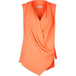 Orange wrap front sleeveless blouse