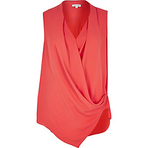 Red wrap front sleeveless blouse