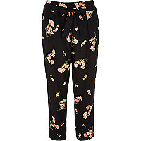 Black floral print tapered cropped trousers