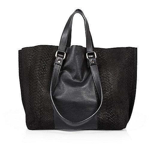 Black leather winged tote handbag