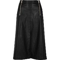 Jupe mi-longue en cuir synthétique noire zippée