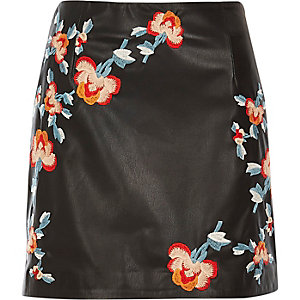 Black leather look embroidered mini skirt