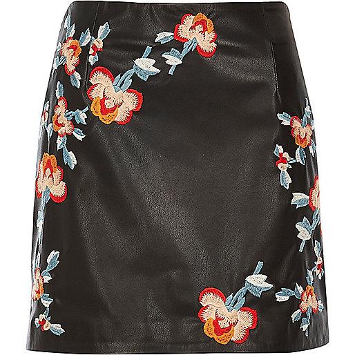 Black leather look embroidered mini skirt