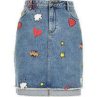 Mid blue wash comic print denim skirt
