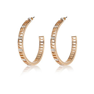 Gold tone encrusted hoop earrings