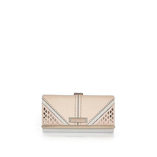 Pink laser cut clip top purse