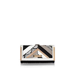 White print clip top purse
