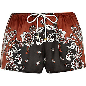 Orange and black floral print pajama shorts