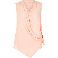Light pink wrap front sleeveless blouse