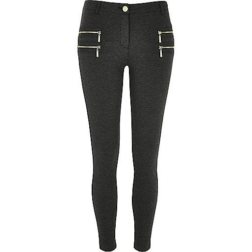 Pantalon super skinny zippé gris