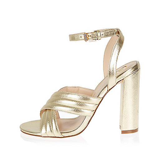 Gold cross strap heels