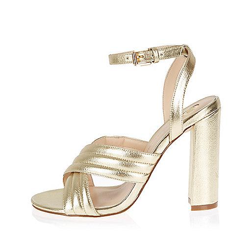 Gold cross strappy heels