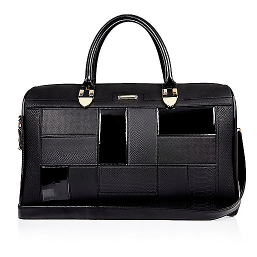 Black patent panel holdall