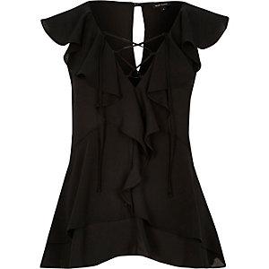 Black frilly blouse