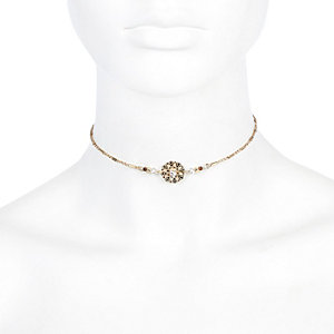 Gold tone filigree crystal choker