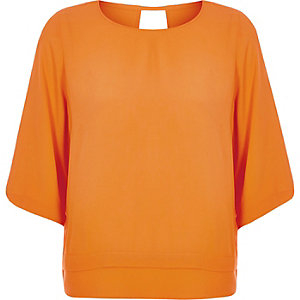 Orange layered hem top