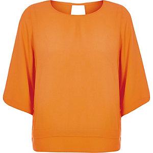 Orange layered hem top