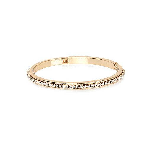 Gold tone gem encrusted bangle