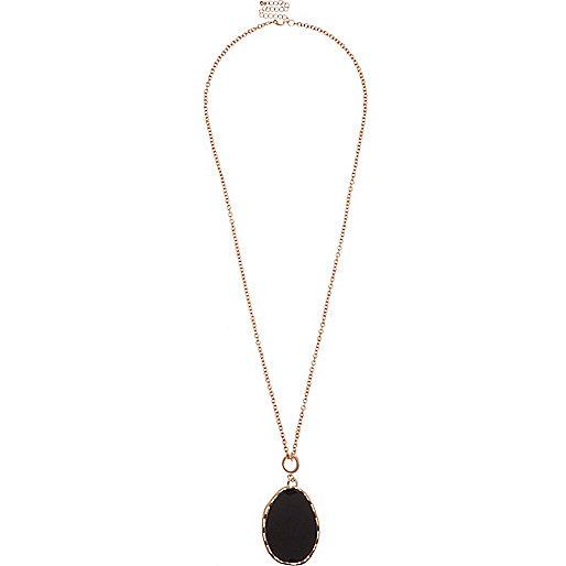 Collier doré rose orné de pierres noires