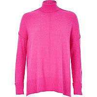 Bright pink turtleneck boxy sweater