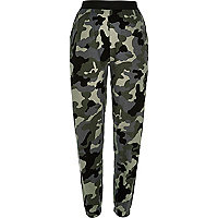 Green camouflage print joggers