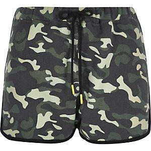 Green camouflage print jersey runner shorts
